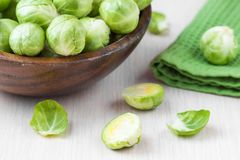 Brussels sprouts in a wooden bowl on the table, tasty, healthy. Vegetable bio products Stock Photography