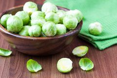 Brussels sprouts in a wooden bowl on the table, tasty, healthy. Vegetable bio products Royalty Free Stock Images