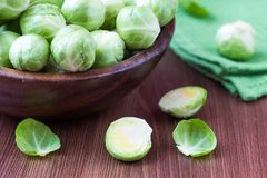 Brussels sprouts in a wooden bowl on the table, tasty, healthy v Royalty Free Stock Photography