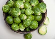 Brussels Sprouts in wooden bowl  on white Royalty Free Stock Photography
