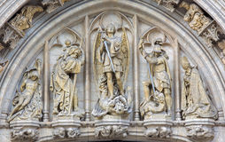 Brussels - St. Michael the archangel on the gothic facade of Town hall. Stock Photo