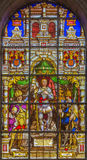 Brussels - Stained glass window depicting the Archangel Gabriel in the center (1843) in the cathedral of st. Michael Stock Images