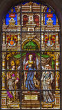 Brussels - Stained glass window depicting st. Gudula in the center (1843) in the cathedral of st. Michael Royalty Free Stock Image