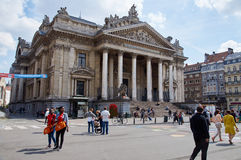 Brussels Stock exchange. Brussels, Belgium - July 31, 2015: Brussels Stock exchange with people walking in middle of the streets. The center of Brussels is now stock photos