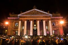 Brussels Stock Exchange and christmas market at night royalty free stock image