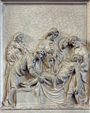 Brussels - Stone relief the Burial of Jesus scene in church Notre Dame du Bon Secource. Stock Photos