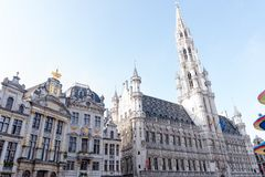 Brussels Town Hall and Maison des Brasseurs. The Town Hall Hôtel de Ville or Stadhuis, the central edifice on the Grand Place in Brussels, Belgium, and the Royalty Free Stock Images