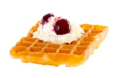 Brussels waffle with cream and cherries brightened Royalty Free Stock Photography