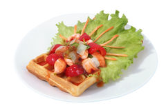 Brussels waffle on plate with lettuce leaf, paprika and fish. Royalty Free Stock Photo