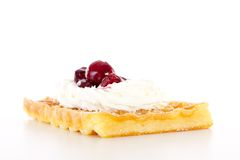 Brussels waffle with whipping cream and sour cherries Stock Photos
