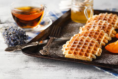 Brussels waffles on the old tray Stock Image