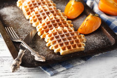 Brussels waffles on the old tray Royalty Free Stock Photography