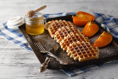 Brussels waffles on the old tray Stock Images