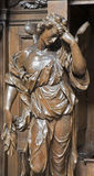Brussesl - Wooden statue of angels on the confession room from Saint Michael and Saint Gulda cathedral Stock Photos