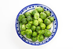 Brussles sprouts. Loads of raw brussels sprouts in a white and blue bowl stock photography
