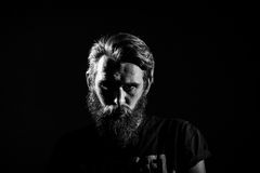Brutal angry biker. On a dark background Royalty Free Stock Images