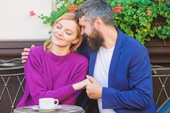Brutal bearded hipster man and woman drink coffee. woman and man with beard relax in cafe. Couple in love on romantic royalty free stock photo