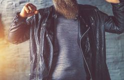 Brutal bearded man in a leather jacket stock photo