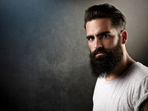 Brutal bearded man with tattoos Stock Image