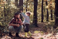 Brutal bearded man and little boy enjoy autumn nature. Family leisure. Family values. Explore nature. Wanderlust concept royalty free stock photo