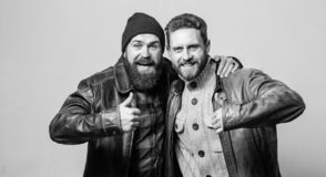 Brutal bearded men wear leather jackets. Real men and brotherhood. Friends glad see each other. Friendly relations. Friendship of brutal guys. Real friendship royalty free stock photos