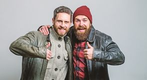 Brutal bearded men wear leather jackets. Real men and brotherhood. Friends glad see each other. Friendly relations. Friendship of brutal guys. Real friendship royalty free stock images