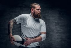 Brutal bearded rugby player in action. royalty free stock photography