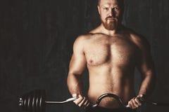 Brutal bodybuilder. Deadlift barbells workout. Royalty Free Stock Photography