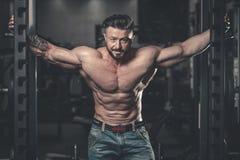 Brutal caucasian handsome fitness men on diet training chest pum Stock Photos