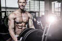 Brutal caucasian handsome fitness men on diet training chest pum Stock Photography