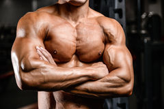 Brutal caucasian handsome fitness men on diet training chest pum. Brutal caucasian handsome fitness man on diet training chest pumping up body Royalty Free Stock Photo