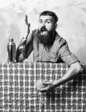Brutal caucasian hipster holding tropical alcohol fresh cocktail. Bearded man, long beard. Brutal caucasian tattooed hipster with moustache in denim shirt stock photos
