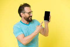 Brutal caucasian hipster with moustache. Mature hipster with beard. Bearded man. Male barber care. Trying to help. Someone. smart man in glasses hold smartphone royalty free stock photos