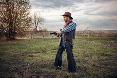 Brutal cowboy with revolver, gunfight on ranch royalty free stock photography