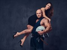Firefighter holds a woman. Royalty Free Stock Photo