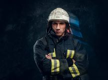 Free Brutal Fireman In Uniform Posing For The Camera Standing With Crossed Arms And Confident Look. Stock Images - 139950864