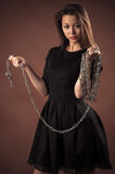Brutal korean girl with chain in hands Stock Photo