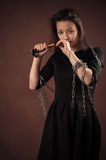 Brutal korean girl with sword. On brown background stock image