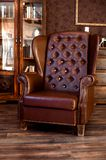 Brutal leather chair in the office of a rich man. Brutal leather empty chair in the office of a rich man or businessman stock images