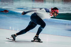 Brutal man athlete speedskater warming up before race sprint distance Royalty Free Stock Photo