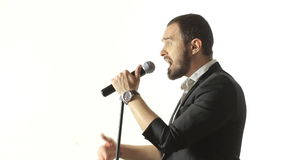 Brutal man with a beard sings into the microphone stock footage