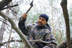 Brutal man chopping wood Stock Photos