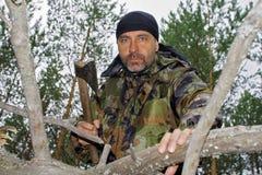 Brutal man chopping wood Royalty Free Stock Photos