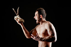 Brutal man with a deer skull Stock Images