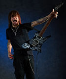 Brutal man with electric guitar Royalty Free Stock Photography