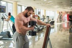 Brutal man in gym. Royalty Free Stock Image