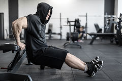 Brutal man in gym Royalty Free Stock Images