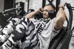 Brutal man`s workout in gym Royalty Free Stock Image