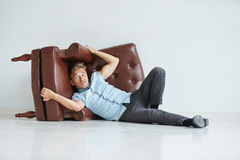 Brutal man in a shirt with short sleeves sitting in the chair , Stock Photos