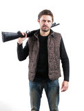 Brutal man with shotgun on white background.  Stock Photography